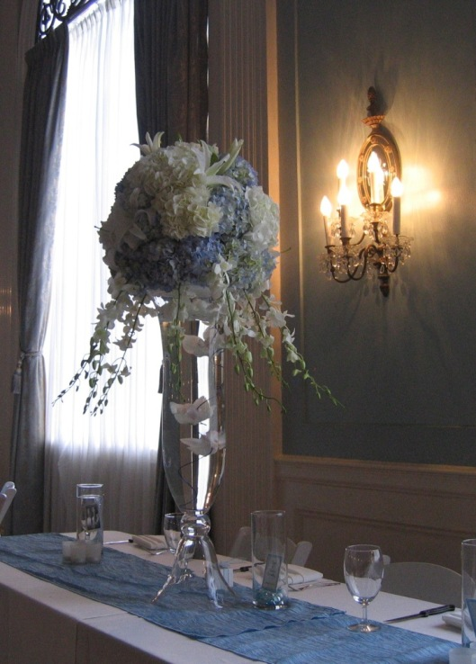Soft, heavenly centerpiece in shades of blue and white.