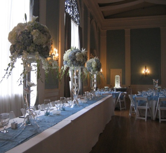 Gorgeous centerpieces in blue and white grace the head table.