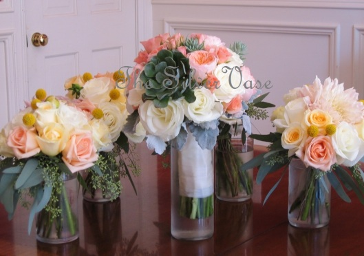 Pastel and peach bouquets with succulent accent.